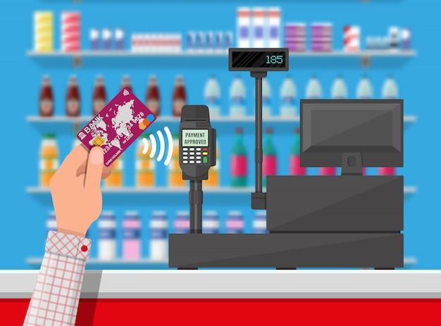 Pagamento senza fili in un supermercato