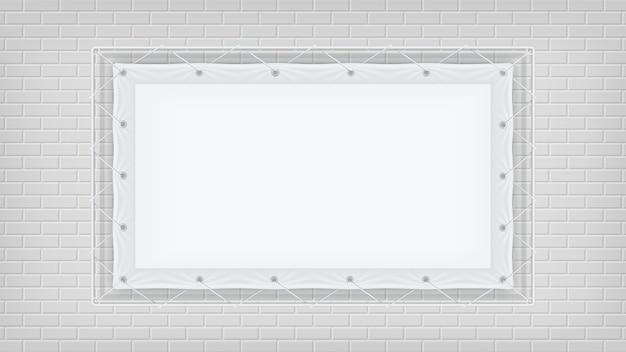 Pagina che appende con sul muro di mattoni bianco