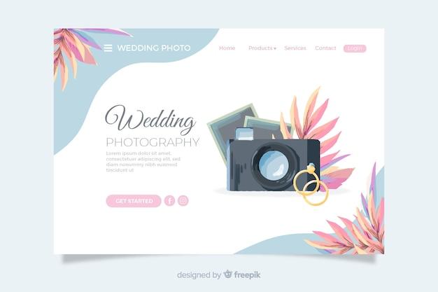 Pagina di destinazione del matrimonio con fotocamera e anelli