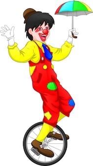 Pagliaccio del fumetto che guida una bici della ruota