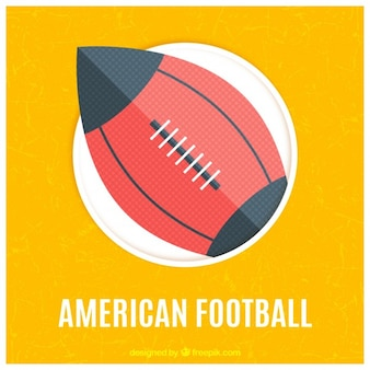 Palla di football americano su uno sfondo giallo