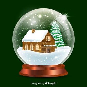 Palla di neve realistica della cabina di natale