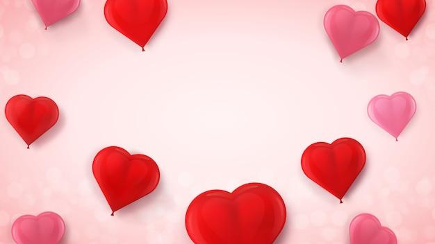 Palloncini a forma di cuore rosso e rosa ad aria eseguiti in modo realistico. festa di palloncini volanti. decorazione festiva dell'invito di san valentino, del giorno delle donne o di nozze su roseo