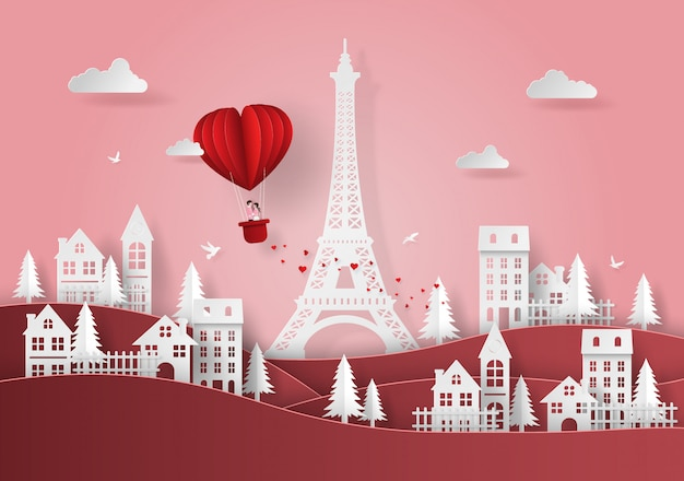 Palloncino a forma di cuore rosso che galleggia sopra il villaggio
