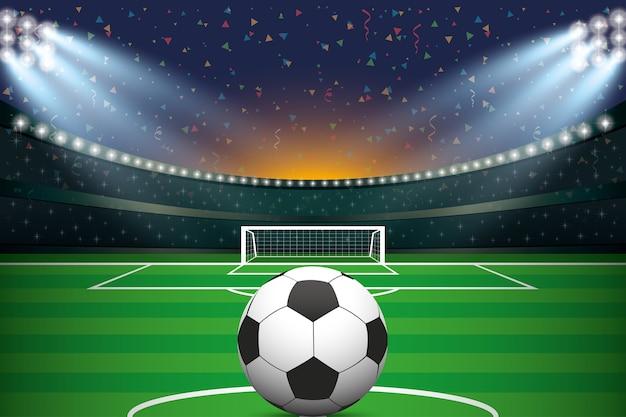 Pallone da calcio con stadio di calcio e sfondo coriandoli.