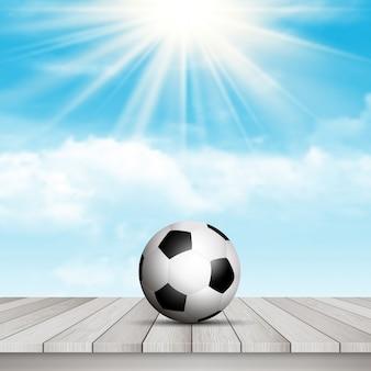 Pallone da calcio sul tavolo contro il cielo blu