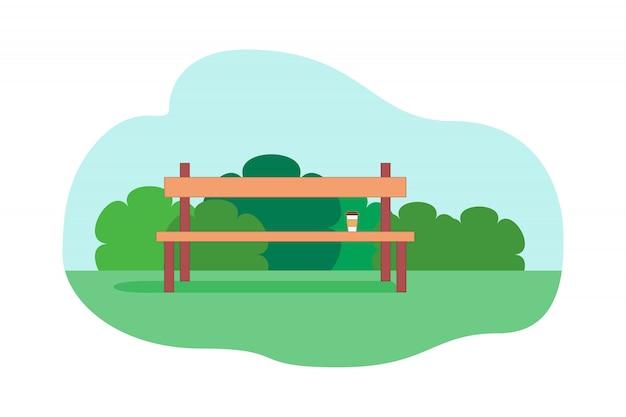 Panca con tazza di caffè in piedi in un parco