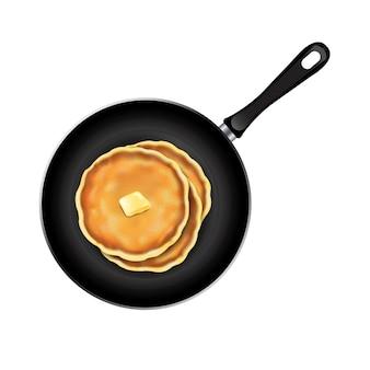 Pancake nel fondo di bianco della padella
