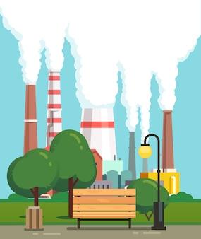 Panchina del parco urbano vicino alle tubazioni di fabbrica inquinanti dell'aria