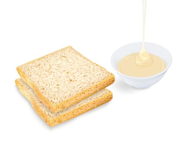 Pane con il versamento del latte condensato in tazza su bianco
