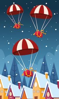 Paracadute che cadono con i contenitori di regali sopra le case alla notte nevosa, deisign variopinto, illustrazione
