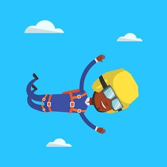 Paracadutista che salta con il paracadute.
