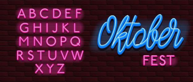 Parete di mattoni di fonte tipografica al neon di alfabeto della fonte più oktoberfest