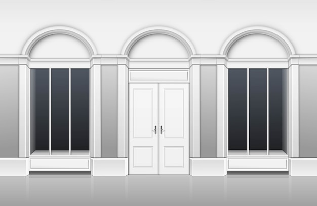 Parte anteriore classica del deposito della costruzione di boutique del negozio con la vetrina di windows, a porta chiusa e posto per il nome isolato su fondo bianco