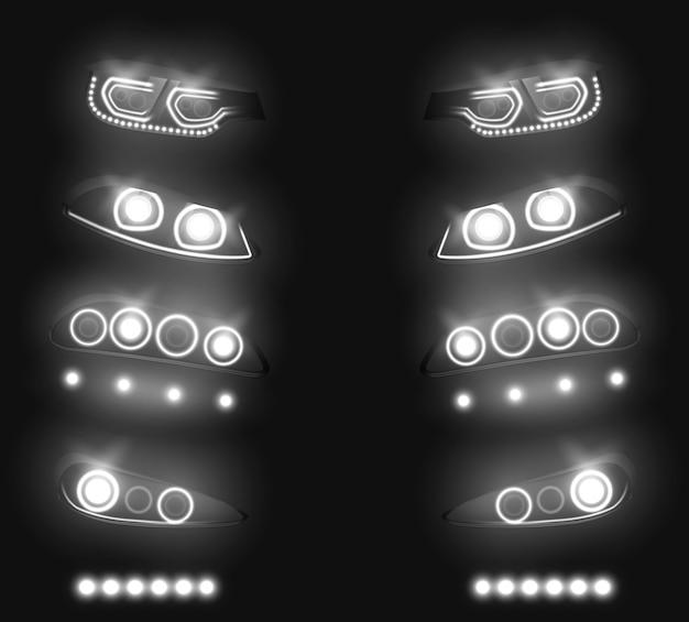 Parte anteriore dell'automobile moderna, insieme realistico di vettore dei fari posteriori. bianco commutato e incandescente nelle tenebre, veicolo led, xenon o luci di corsa laser illustrazione isolato su fondo nero. attrezzature per l'industria automobilistica
