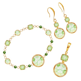 Parure di orecchini, ciondolo e bracciali. pietra preziosa quadrata verde, a goccia e rotonda con elemento in oro. bei cristalli di disegno dell'acquerello sulla catena dorata. concetto di gioielleria