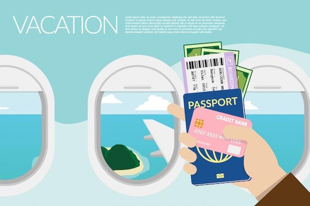 Passaporto della holding della mano, carta d'imbarco con vista fuori dalla finestra sull'aereo in background.