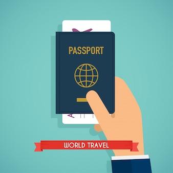 Passaporto della holding della mano con i biglietti.
