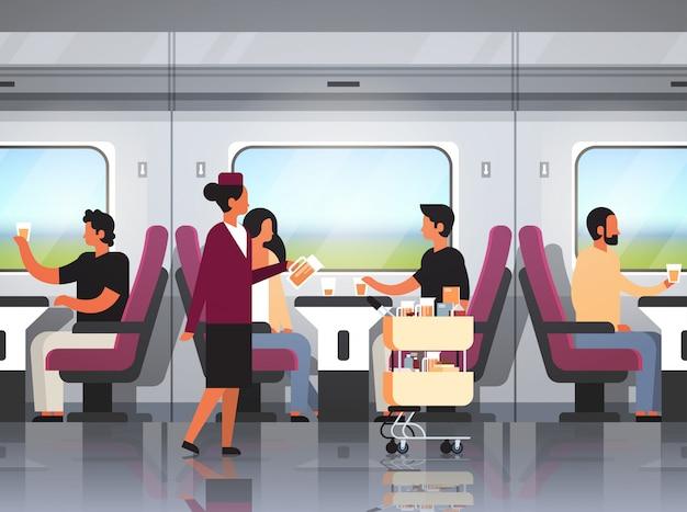 Passeggeri che viaggiano in treno espresso moderno