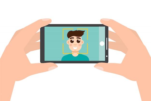 Passi lo smartphone della tenuta e la presa della foto, selfie.