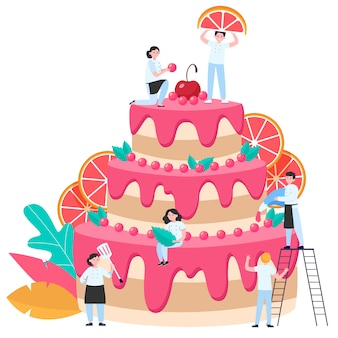 Pasticceri che decorano una grande torta nuziale o di compleanno