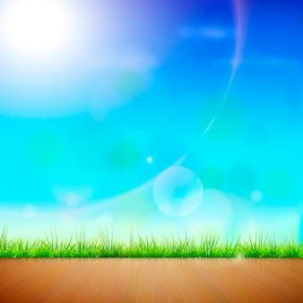 Pavimento in legno con sfondo verde erba