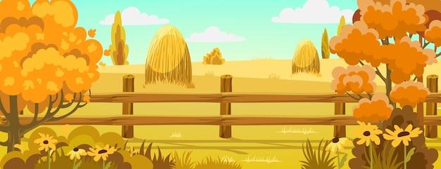 Peisage di un campo con mucchi di fieno vicino a una foresta