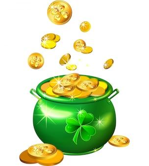 Pentola verde di giorno del `s di st patrick con le monete di oro