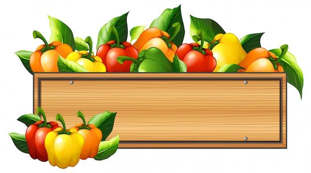 Peperoni e tavola di legno
