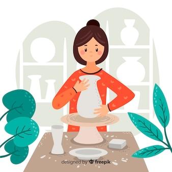 Persona a casa facendo ceramiche
