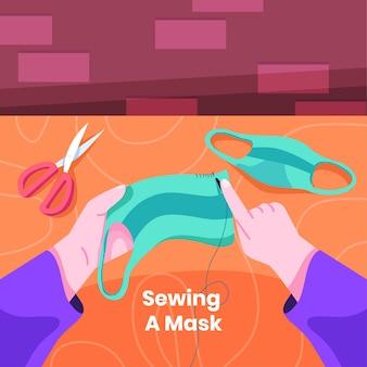 Persona che cuce una maschera medica
