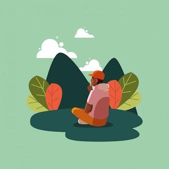 Persona dell'uomo dell'avatar che si siede sull'erba