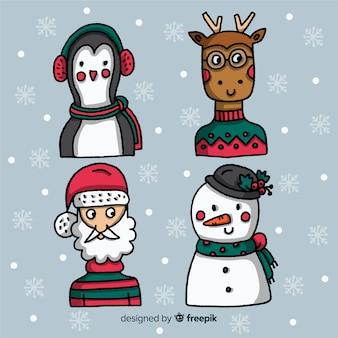 Personaggi natalizi con neve sullo sfondo