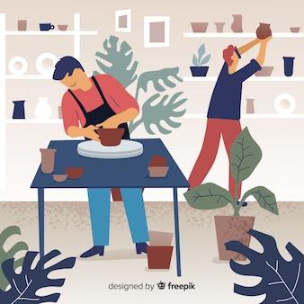 Persone a casa facendo ceramiche