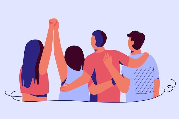 Persone che abbracciano e si tengono per mano evento della giornata della gioventù