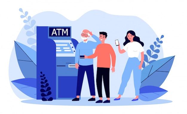 Persone che aiutano uomo anziano al bancomat