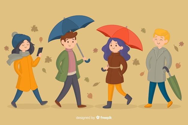 Persone che camminano in autunno collettivo
