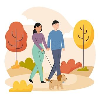 Persone che camminano in autunno