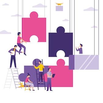 Persone che costruiscono e collegano puzzle