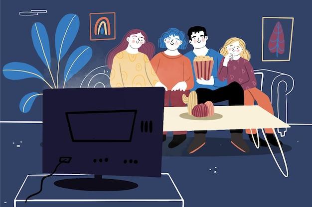 Persone che guardano un film a casa