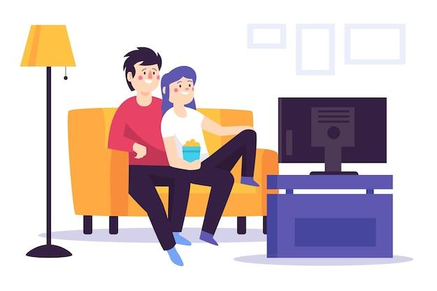 Persone che guardano un film insieme a casa