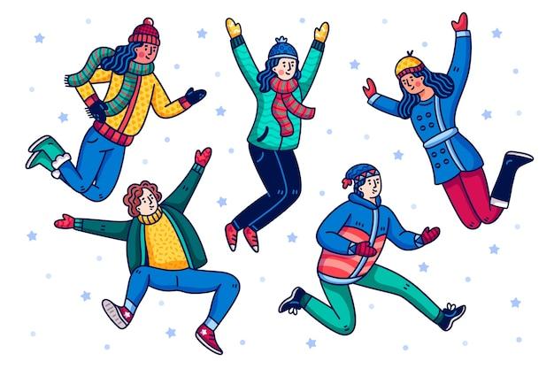 Persone che indossano abiti invernali saltando