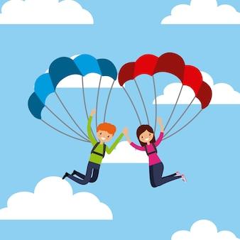 Persone che lanciano i paracadute