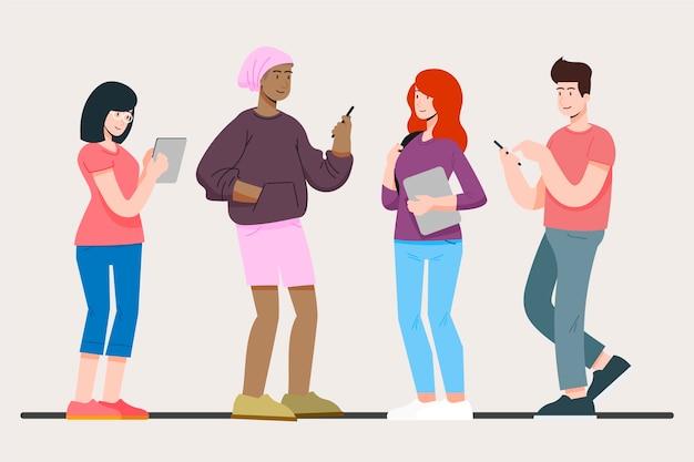 Persone con varietà di dispositivi tecnologici