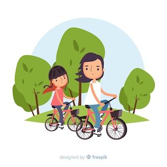 Persone in bicicletta nel parco