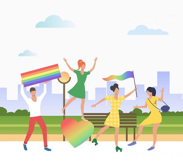 Persone in possesso di bandiere lgbt in orgoglio sfilata