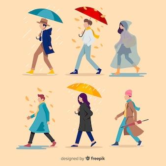 Persone piatte che camminano in autunno