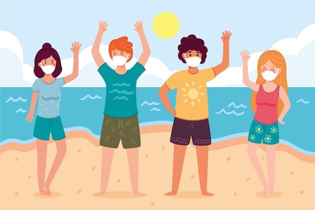 Persone sulla spiaggia indossando maschera