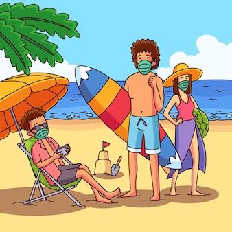 Persone sulla spiaggia indossando maschere