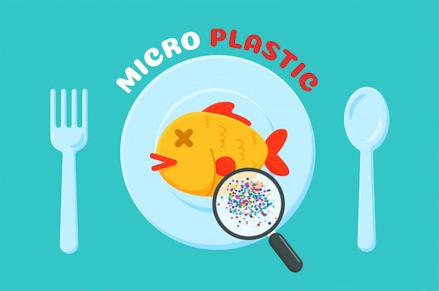 Pesce morto su un piatto pieno di microplastica